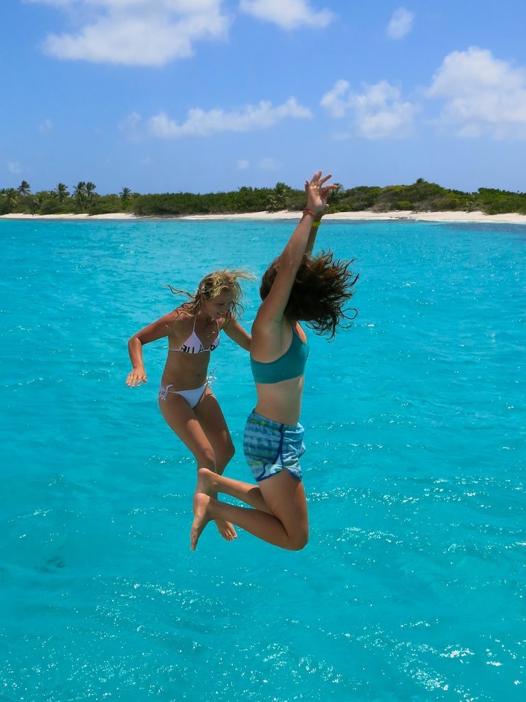 Jumping into clear blue waters